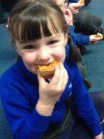 Aut 1: Enjoying French breakfast. We worked on using our manners in French, using 'oui merci' or 'non merci'.